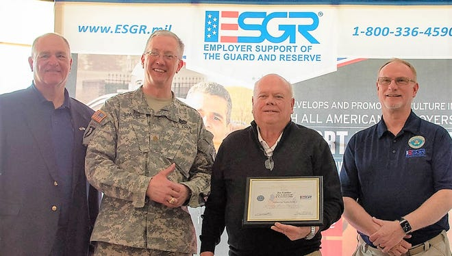 Joe Lasitor, third from left, of Alto Lakes Golf & Country Club received the Patriotic Employer award,  nominated by MAJ Keith Spaniel, Army Reserve.