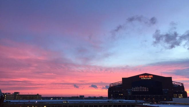 The sun sets spectacularly over Lucas Oil Stadium on Jan. 6, 2014.