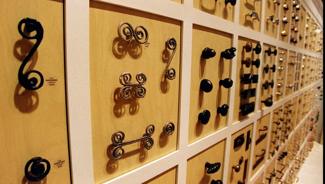A collection of knobs and handle reproductions for cabinets and drawers fill an entire wall in there Corte Madera, Calif., showroom of the rapidly growing home furnishings company with Northern California roots Restoration Hardware, Wednesday, June 11, 1997.