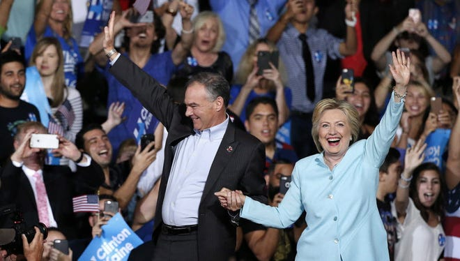 Democratic presidential candidate Hillary Clinton (R) introduces her Vice Presidential candidate Senator Tim Kaine (L) at Florida International University, Miami, Florida, July 23, 2016.