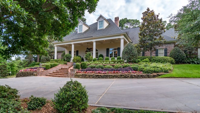 This Louisiana Acadian style beauty with nods to master architect A. Hays Town is listed at $1,950,000.