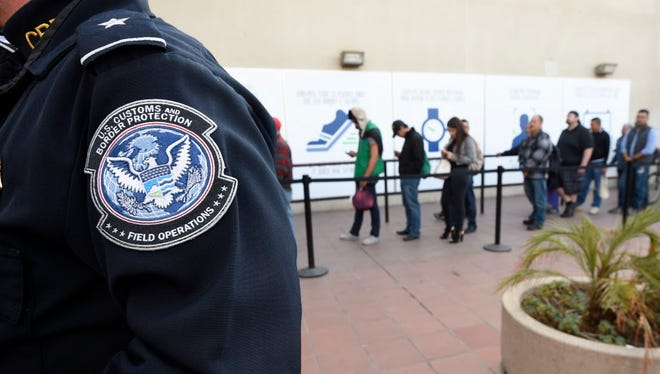 Pedestrians crossing from Mexico into the USA at the Otay Mesa Port of Entry wait in line Dec. 10, 2015, in San Diego.