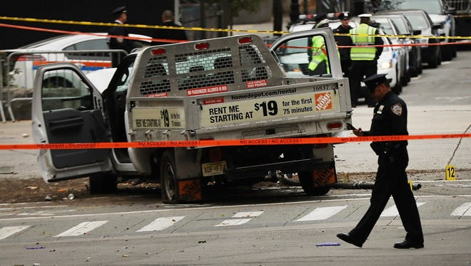The crashed vehicle used in what is being described as a terrorist attack sits in lower Manhattan the morning after the event on November 1, 2017 in New York City.  Eight people were killed and 12 were injured on Tuesday afternoon when suspect 29-year-old Sayfullo Saipov, a legal resident from Uzbekistan, intentionally drove a truck onto a bike path in lower Manhattan.