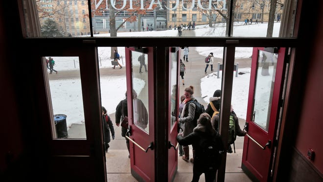 University of Wisconsin-Madison students come and go from the Education Building between classes at the public university in Madison, Wis., Tuesday, Jan. 27, 2015.