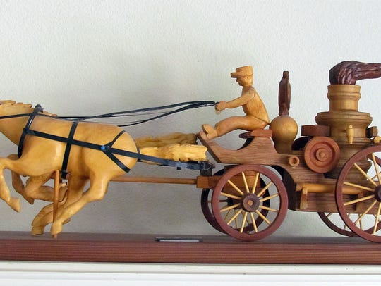 A horse and carriage Caryl Prince made by using a dental
