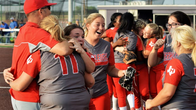 The Hermleigh Lady Cardinals celebrate clinching a berth in the state tournament following Thursday's 19-3 win over Ira at ACU.
