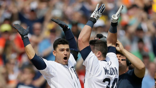 Detroit Tigers' James McCann (34) celebrates his walkoff home run during the ninth inning off Chicago White Sox relief pitcher Zach Putnam with teammate Jose Iglesias in a baseball game, Sunday, June 28, 2015, in Detroit. The Tigers defeated the White Sox 5-4.