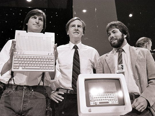 In this April 24, 1984 file photo, Steve Jobs, left,