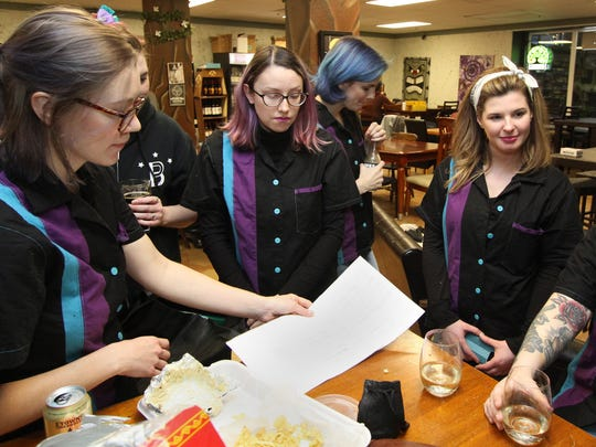 Ashley's Avengers, the home team for Ashley's Pub in Bremerton, sets up their strategy for a meet against the Slippery Pig team from Poulsbo.