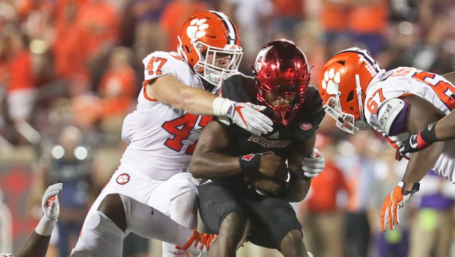 Louisville's Lamar Jackson gets sacked by Clemson in the second half.