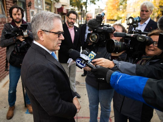 Democratic nominee for Philadelphia district attorney Larry Krasner speaks with members of the media out side his polling place after voting in Philadelphia, Tuesday, Nov. 7, 2017. His opponent is Republican Beth Grossman.