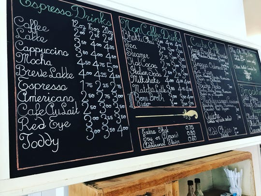 A chalkboard menu at the new Me Oh My bakery and coffee shop in Laporte.