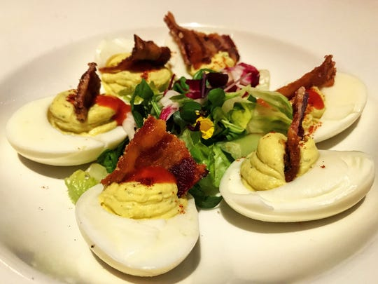 The deviled eggs ($11) are topped with a sweet and spicy millionaire's bacon.