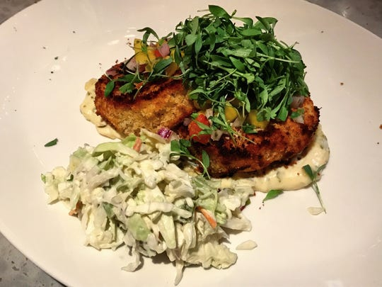 The crab cakes ($29) are prepared Southern style, with cilantro lime tartar sauce and a side of cole slaw.