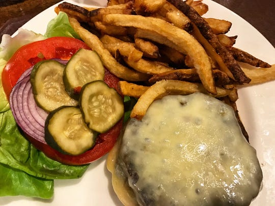 The Tiburón burger ($18) includes Vermont cheddar, house pickles and a secret sauce sandwiched between a grilled brioche bun.