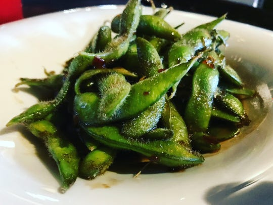 Mojo edamame ($7) with garlic, oregano and orange at The Cave Bistro & Wine Bar.