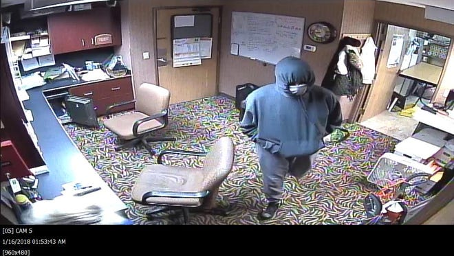 This image was captured on a security camera during a robbery Monday night at the Comfort Inn Hotel on University Park Drive in Alaiedon Township.