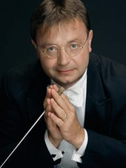 "Guest conductor David Wroe takes the podium for Peninsula Music Festival's ""Hollywood Rhapsody"" on Aug. 8."