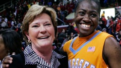 Tennessee head coach Pat Summit, left, hugs player