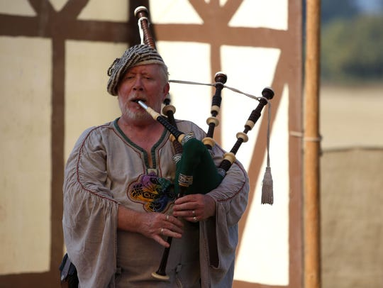 Tom McVey plays the bagpipes at the 2014 Shrewsbury