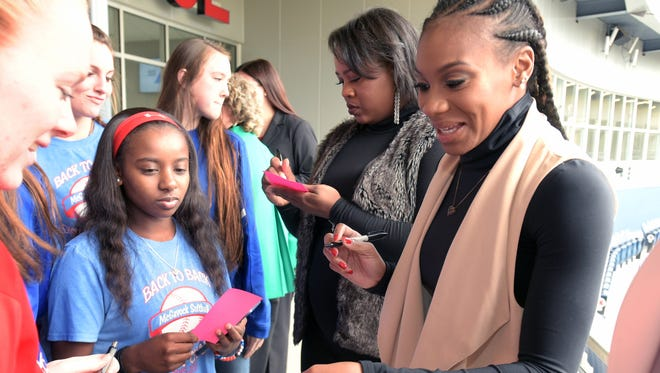 Olympic gold shot put medalist Michelle Carter,left, and track & field athlete Kennetra Searcy, right sign autographs from  McGavock High students  during a meet and greet during the United State of Women Empowerment Forum on Wednesday, Feb. 1, 2017 at First Tennessee Park in Nashville.