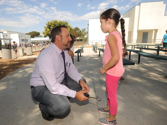 Flory Academy Principal Scott Mastroianni chats with first-grader Giorjana Lucio as he makes his rounds during lunchtime at the Moorpark school recently.