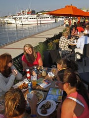 Guests enjoy an evening of outside dining, overlooking Shark River, at 9th Avenue Pier in Belmar.