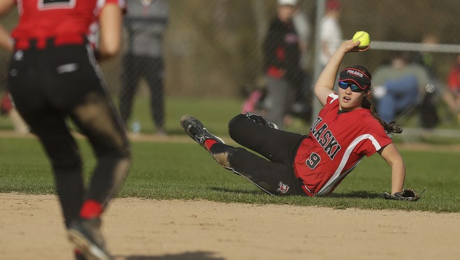 Pulaski infielder Emily Higgins (9) tries to make a play at first base after diving for the ball during a 1-0 victory against Bay Port on May 5. Higgins leads the team with a .375 batting average.