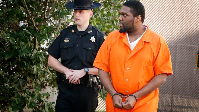 Zecary L. Banks, 27, of Elmira, walks into Chemung County Court for arraignment Tuesday. Banks is a suspect in the July 28 shooting at Patrick's bar on College Avenue in Elmira that left five people injured.