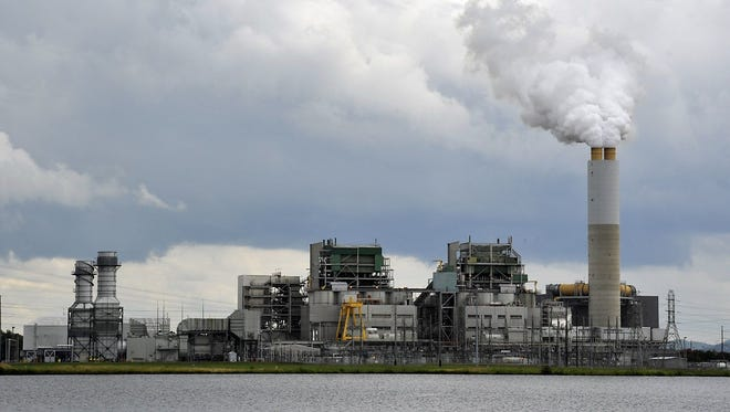 While much of what is emitted through Duke Energy's Lake Julian plant smokestack is steam, but plant does emit pollutants such as sulfur dioxide and mercury, too.