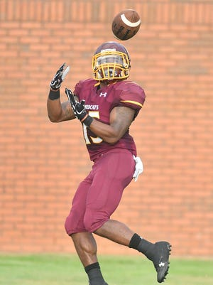 Pearl River running back Ron Thompson catches a first-quarter touchdown pass during the Wildcats' 27-21 victory over Northeast last week at Poplarville.