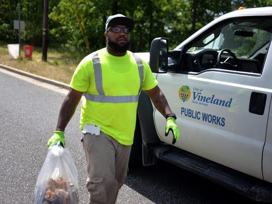 Charles Burnette, of Vineland, cleans up litter at