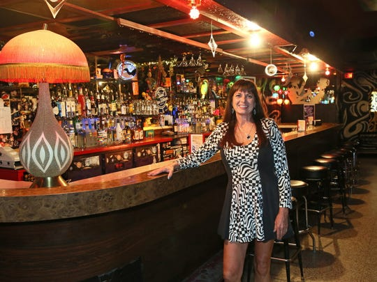 Rosemary Silagy poses at the bar of her eclectic nighttime spot Mad Planet, 533 E. Center St. The club has had a fair share of concerts over its 27 year history, but hasn't booked live music in nine months, focusing instead on its popular dance programming.