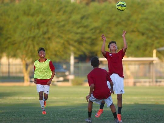 Members of the La Laja under 13 soccer team practices in Coachella, June 27, 2016.
