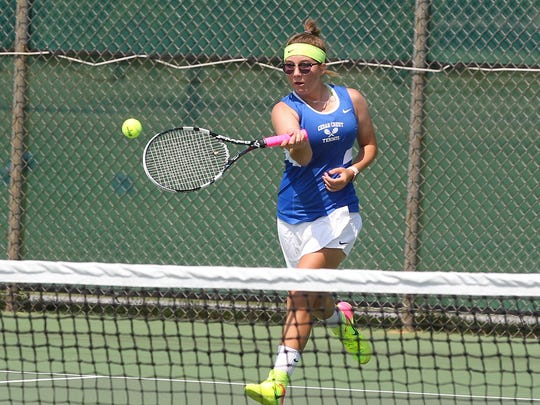 Cedar Crest's Keeley Hartman rips a forehand during Saturday's county singles final.