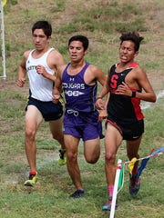 Eastwood's Daniel Bernal (left), Franklin's Adam Cortez and Socorro's Stephen Alvarez will compete Monday at the Region 1-6A Cross Country Meet in Lubbock.