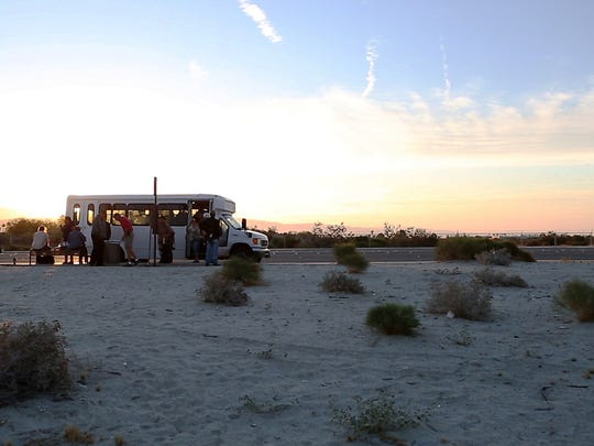 Roy's Desert Resource Center's shuttle drops off it's clients at  6:14 a.m. at the Sunline bus stop on N. Farrell Drive by E. Vista Chino on Thursday, May 5, 2016 in Palm Springs, Calif.