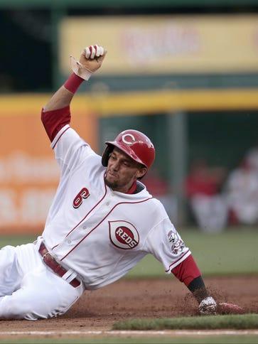 Reds center fielder Billy Hamilton slides in safely