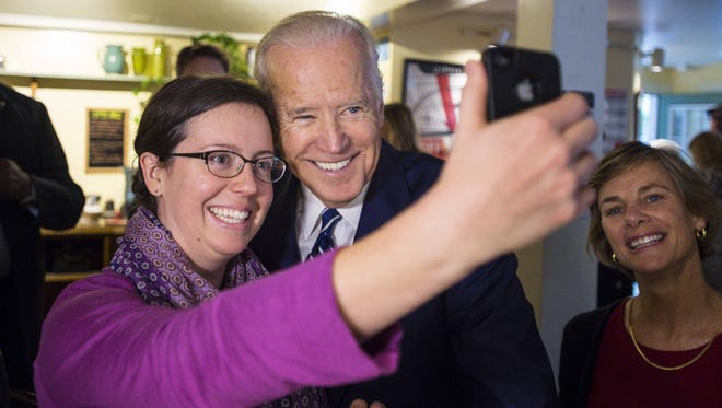 Vice -President Joe Biden poses for a selfie with Christina Lauterbach of Burlington as he greets diners at the Penny Cluse Cafe in Burlington before participating in a Cancer Moonshot Roundtable at the University of Vermont on Friday, October 21, 2016.