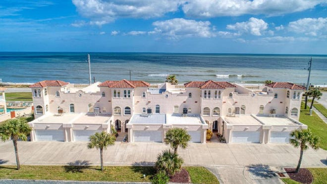 Relax to ocean breezes and watch the sun rise and set from the private deck of this impressive three-story townhome is located on the no-drive north end of Ormond-by-the-Sea.