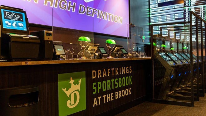 DraftKings Sportsbook at The Brook was opened Wednesday in Seabrook. Sports fans will now be able to place legal bets on all major professional and collegiate U.S. sports at the location.