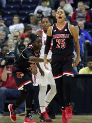 Louisville's Asia Durr celebrates after forcing a turnover.