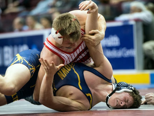Bermudian Springs' Darren Beall, top, earns backpoints