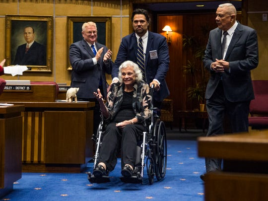 Retired Supreme Court Justice Sandra Day O'Connor enters the Senate Chambers, along with former state Sen. Alfredo Gutierrez (right) on March 15, 2017.