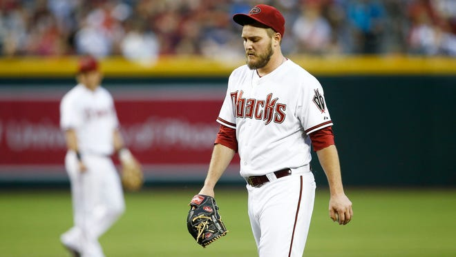 Arizona Diamondbacks pitcher Wade Miley reacts after San Diego Padres Chris Denorfia singled to center, scoring Everth Cabrera in the 3rd inning on Tuesday, May 27, 2014 at Chase field in Phoenix, AZ.
