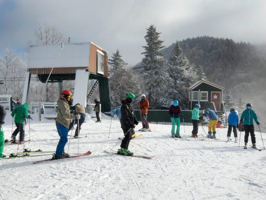 Skiers get ready to take the first run of the season