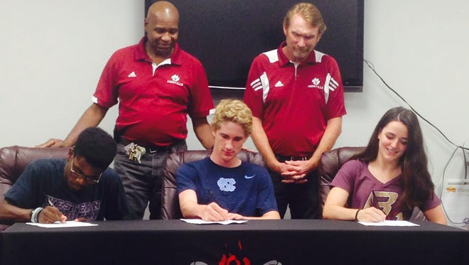 Asheville High seniors, from left to right, Terry Young (Western Carolina University), Noah Shore (North Carolina) and Naomi Cartier (Boston College) have signed to run college cross country and track.