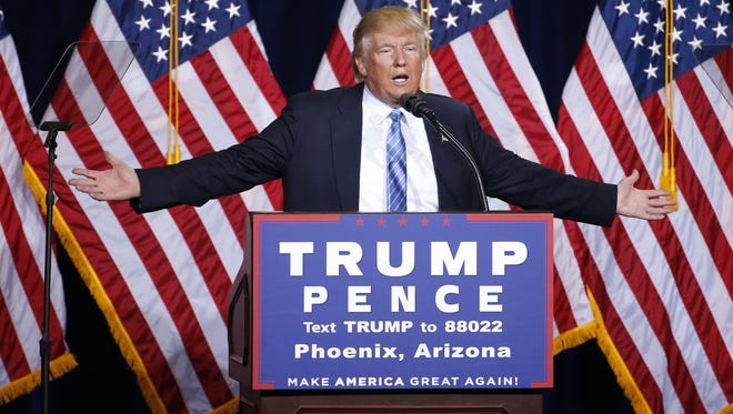 Republican presidential candidate Donald Trump speaks to a crowd at the Phoenix Convention Center in Arizona August 31, 2016.