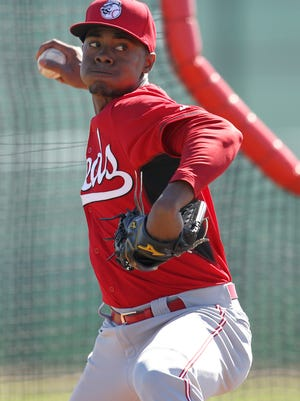 Reds pitcher Raisel Iglesias throws during live batting practice Wednesday.