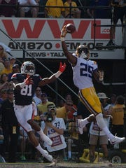 LSU corner back Andraez Williams (29) swats the ball
